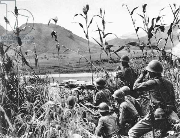 CHINA: JAPANESE INVASION Japanese soldiers in ambush, Northern China, September 1937.