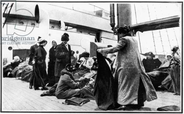 TITANIC: SURVIVORS, 1912 Women passengers on the 'Carpathia' sewing for the 'Titanic' survivors and distributing clothes. Photograph, 1912.