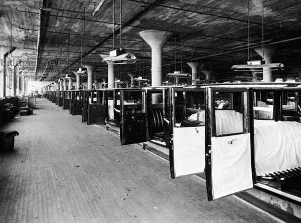 AUTOMOBILE ASSEMBLY LINE An assembly line of Studebaker bodies. Photograph c.1920.