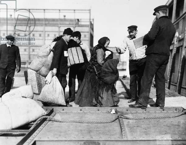 ELLIS ISLAND: IMMIGRANTS European immigrants arriving at the immigration station in New York Harbor, c.1910.