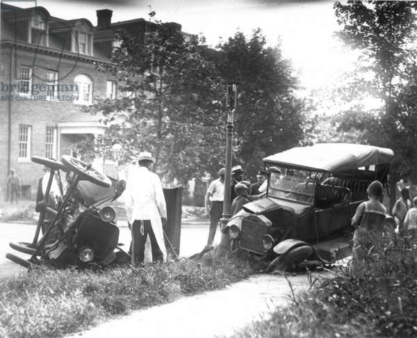 AUTO ACCIDENT An accident involving two Ford Model T's.