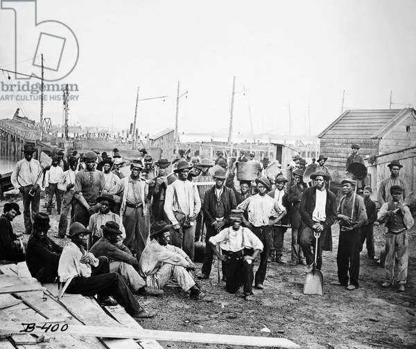 CIVIL WAR: DOCK WORKERS Black dock workers in Virginia photographed during the American Civil War.
