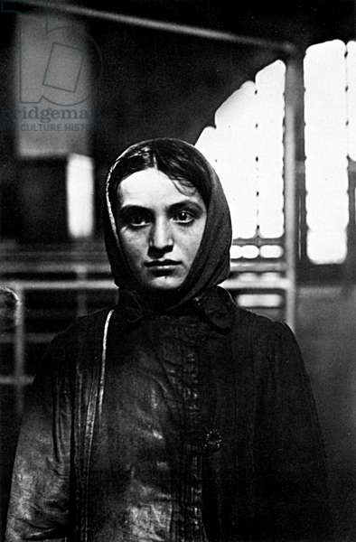 RUSSIAN JEWISH IMMIGRANT A young Russian Jewish woman upon her arrival at Ellis Island, New York City. Photographed by Lewis Hine, 1905.