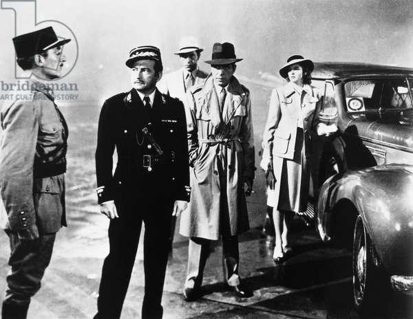 CASABLANCA, 1942 Claude Rains (second from left), Paul Henreid, Humphrey Bogart, and Ingrid Bergman in a scene from 'Casablanca,' 1942.