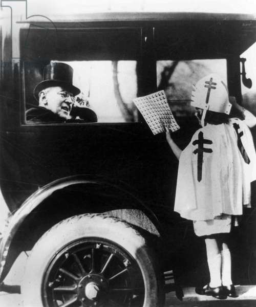 WOODROW WILSON (1856-1924) 28th President of the United States. A composite photograph depicting Wilson stopping on his daily drive to purchase tuberculosis Christmas seals from a young girl, 12 December 1923.