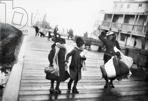 ELLIS ISLAND: IMMIGRANTS A family of Belgian refugees arriving at Ellis Island, New York City. Photograph, 1917.