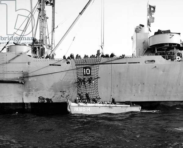 DENMARK: U.S. MARINES, 1952 U.S. Marines disembarking for a beach landing at Jutland, Denmark during Operation Mainbrace, a NATO North Atlantic maneuver, 1952.