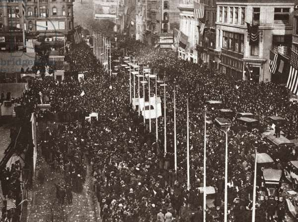 WORLD WAR I: PARADE, 1918 Parade to celebrate the signing of the Armistice on 42nd street and 5th avenune, New York. Photograph, November 11, 1918.