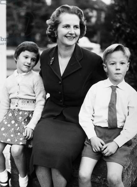 MARGARET THATCHER (1925-2013). English politician. Photographed in 1959 at her home in Farnborough, Kent, with her twin children, Carol and Mark, age six.