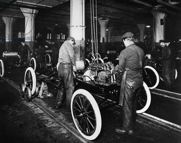 FORD ASSEMBLY LINE, c.1913 The assembly line at the Ford automobile plant in Highland Park, Michigan, c.1913.