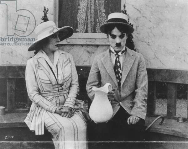 CHAPLIN: 'THE CURE' (1917) Charlie Chaplin and Edna Purviance in The Cure.