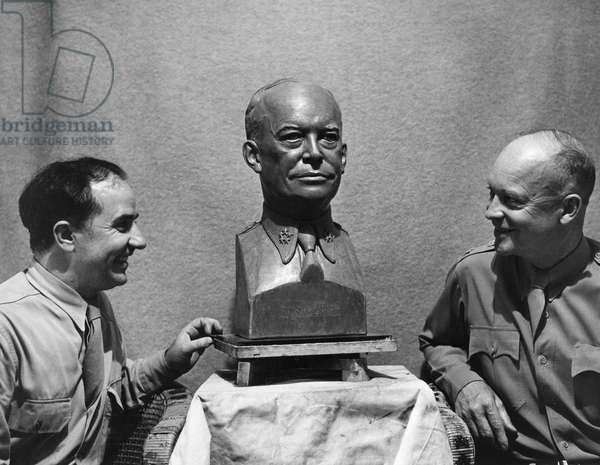 DWIGHT D. EISENHOWER  (1890-1969). 34th President of the United States. Photographed with a sculpture and the sculptor Archimedes Giacomantonio, 1945.