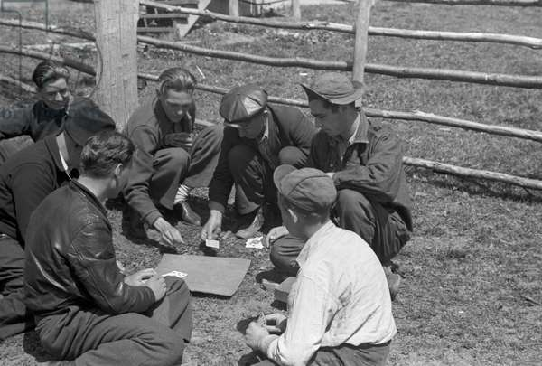 MINER STRIKE, 1939 Miners playing cards during a coal strike in Kempton, West Virginia. Photograph by John Vachon, May 1939.