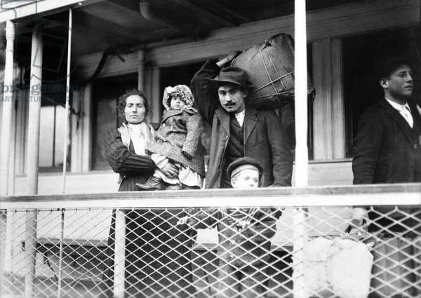 ITALIAN IMMIGRANT FAMILY A family of Italian immigrants on board the Ellis Island ferry to Manhattan. Photograph by Lewis Hine, c.1905.