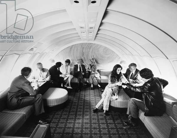 AMERICAN AIRLINES LOUNGE A lounge on board an American Airlines Boeing 747 airplane. Photograph, c.1975.