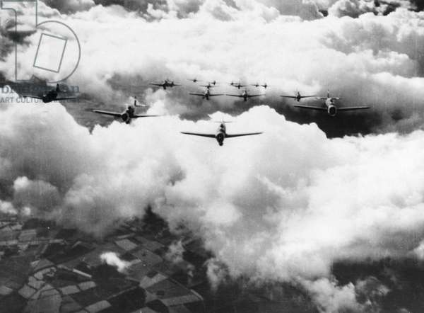 WORLD WAR II: THUNDERBOLT An entire squadron of P-47 Thunderbolts flying over the English Channel as escorts to B-17 Flying Fortresses on a bombing mission. Photographed 1943.