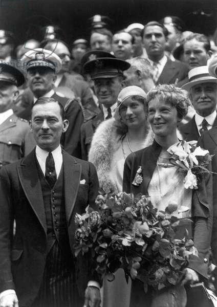 AMELIA EARHART (1897-1937) American aviator. Photographed standing with Mayor James Walker of New York in 1932.