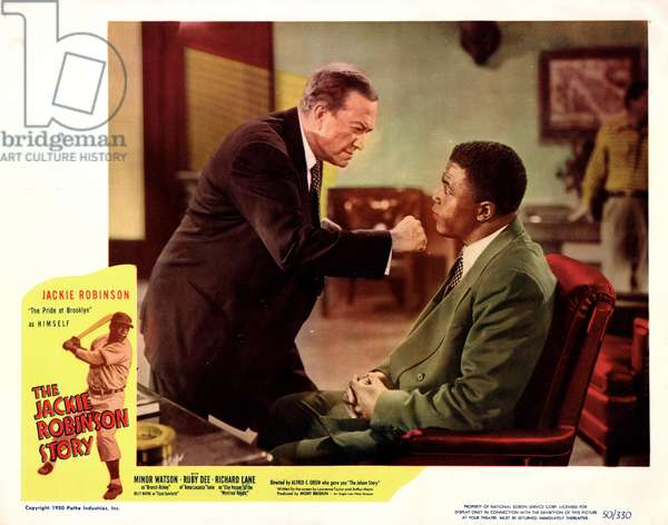 JACKIE ROBINSON (1919-1972) American baseball player. Film still from 'The Jackie Robinson Story,' with Minor Watson as Dodgers President and General Manager Branch Rickey. Lobby card, c.1950.