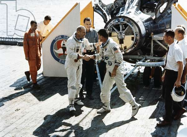 GEMINI 6, 1965 Astronauts Walter M. Schirra Jr. and Thomas P. Stafford aboard the aircraft carrier USS Wasp after the Gemini 6 mission. Photograph, 1965.