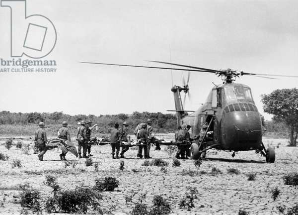 VIETNAM WAR: WOUNDED Wounded South Vietnamese soldiers are carried to a medical evacuation helicopter, March 1964.