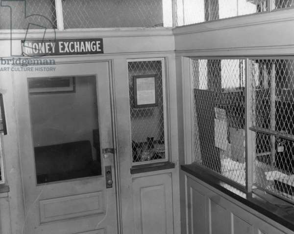 ELLIS ISLAND, c.1940 Money exchange room at Ellis Island. Photograph, c.1940.