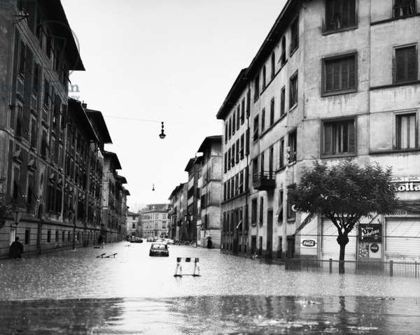 FLORENCE: FLOOD, 1966 Cars stranded in a street in Florence, Italy, during the flood of the Arno River. Photograph, 5 November 1966.