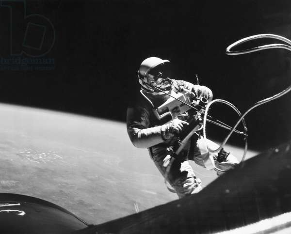 SPACE: GEMINI 4, 1965 Astronaut Edward H. White performing his spectacular space feat during the 3rd orbit of the Gemini-Titan 4 flight, 1965.