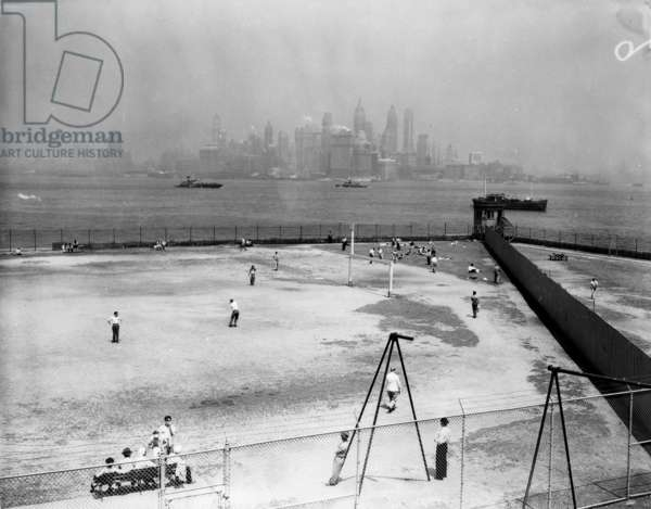 ELLIS ISLAND, c.1945 Athletic fields at Ellis Island, when it served as a detention and deportation processing center. Photograph, c.1945.