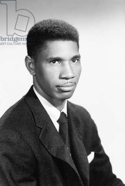 MEDGAR EVERS (1925-1963) American civil rights activist. Photograph, c.1960.