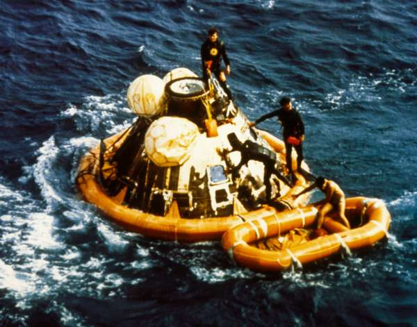 APOLLO 11: SPLASHDOWN, 1969 Recovery operation of the Apollo 11 capsule in the Pacific Ocean after splashdown, 24 July 1969.