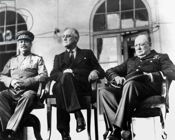 WWII: TEHRAN CONFERENCE Soviet Premier Joseph Stalin, U.S. President Franklin D. Roosevelt, and British Prime Minister Winston Churchill at the Tehran Conference, November 1943, to discuss war plans.