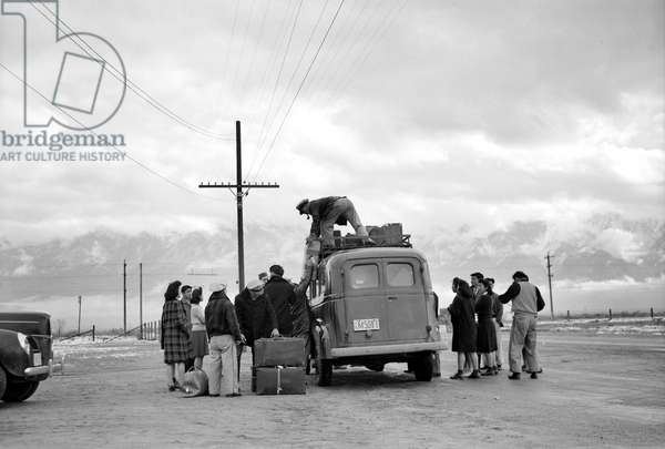 JAPANESE INTERNMENT, 1943 Group of Japanese-Americans preparing to leave the Manzanar Relocation Center at Owens Valley, California. Photograph by Ansel Adams, 1943.