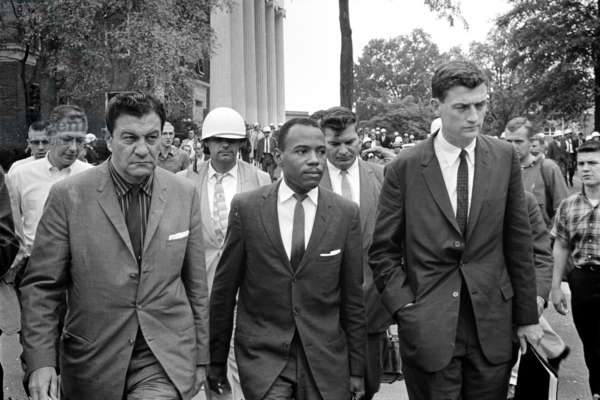JAMES MEREDITH (1933- ) Civil rights activist and the first African American to attend the University of Mississippi. Meredith walking to class accompanied by two U.S. Marshals, 1 October 1962. Photographed by Marion S. Trikosko.
