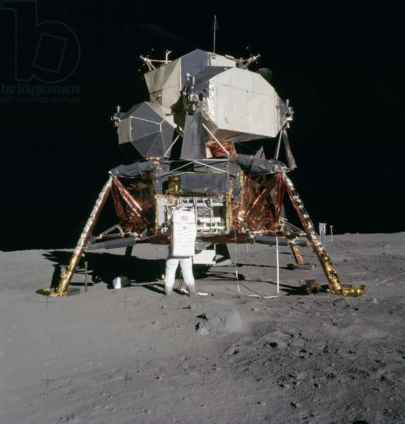 APOLLO 11, 1969 Astronaut Edwin 'Buzz' Aldrin unpacking experiments from the Lunar Module on the moon during the Apollo 11 mission. Photographed by Neil Armstrong, 20 July 1969.