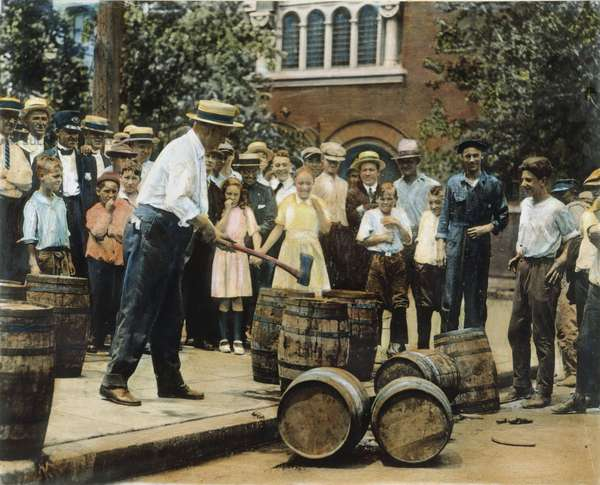 PROHIBITION, 1920s A federal agent destroying illicit whiskey in Chicago during Prohibition in the 1920s: oil over a photograph.