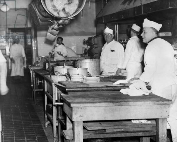 ELLIS ISLAND, c.1943 Detained 'enemy aliens' working in the kitchen at Ellis Island during World War II. Photograph, c.1943.