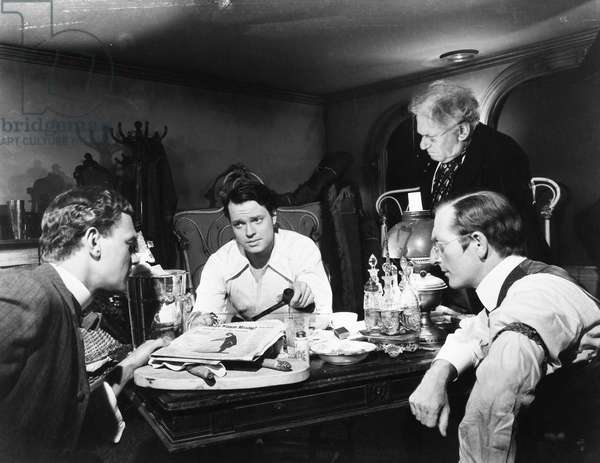 FILM: CITIZEN KANE, 1941 Joseph Cotten, Orson Welles, and Everett Sloane (seated left-to-right) in a scene from the 1941 motion picture 'Citizen Kane.'
