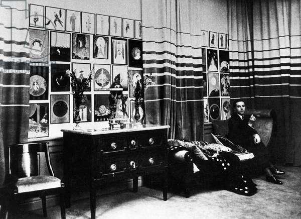 ERTÉ (1892-1990) Pseudonym of Romain de Tirtoff, French (Russian-born) artist and designer. Photographed in his Paris studio, c.1925.