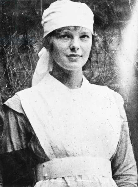 AMELIA EARHART (1897-1937) American aviator. Photographed while serving as a nurse's aid in Canada, 1918.