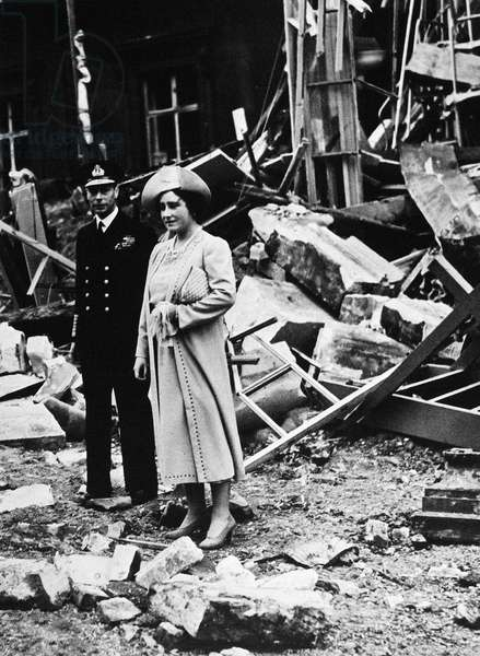 LONDON BLITZ, 1940 King George VI and Queen Elizabeth inspect parts of Buckingham Palace that had been bombed during a German air raid on London. Photographed by Reggie Speller, 11 September 1940.