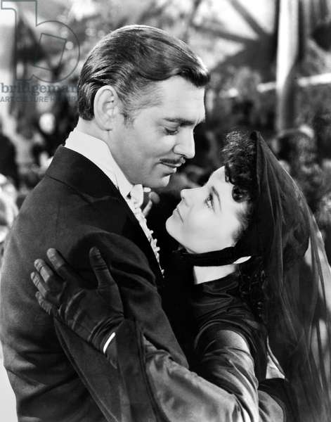 GONE WITH THE WIND, 1939 Vivien Leigh as Scarlett O'Hara and Clark Gable as Rhett Butler in the film 'Gone with the Wind' directed by Victor Fleming, 1939, after Margaret Mitchell's novel.