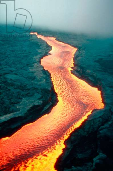 HAWAII: VOLCANOS, 1984 A river of lava at Mauna Loa, during a dual eruption of the Mauna Loa and Kilauea volcanos on the island of Hawaii, 30 March 1984. Photograph by Scott Lopez.