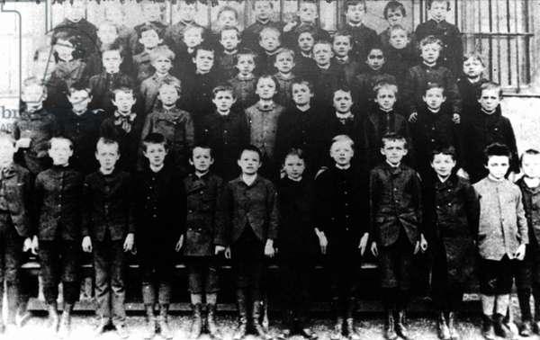 ALBERT EINSTEIN (1879-1955) Einstein (front row, third from right) in a class photograph at Lutipold Gymnasium, Munich, Germany. Photograph, 1889.