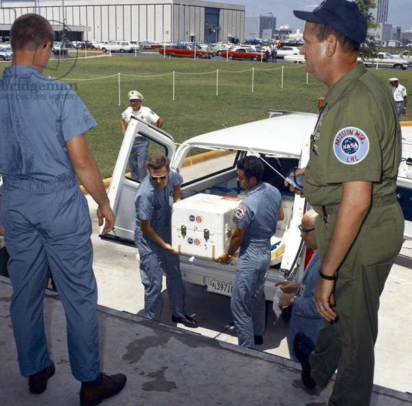 APOLLO 11: ROCK BOX, 1969 NASA personnel unloading a box containing lunar samples collected by the Apollo 11 astronauts, at the Manned Spacecraft Center in Houston, Texas. Photograph, 1969.