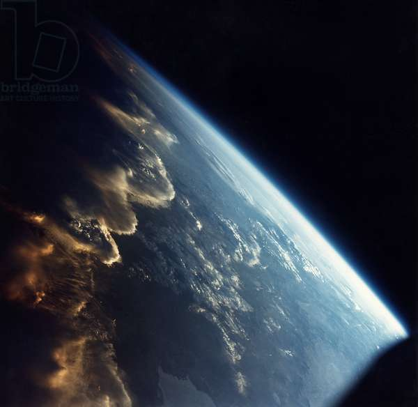 EARTH FROM SPACE, 1965 Illuminated clouds in the Andes Mountains in South America. Photographed by James Lovell and Frank Borman from the Gemini VII spacecraft, 1965.