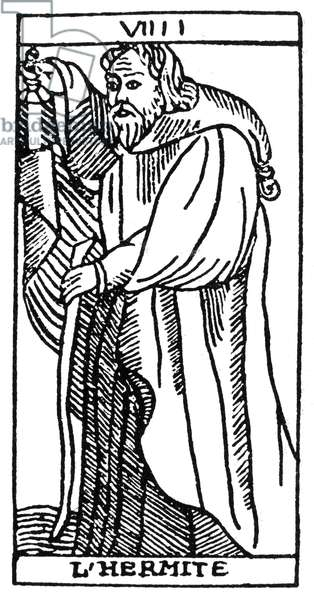 TAROT CARD: THE HERMIT 'The Hermit (Prudence).' Woodcut, French, Marseille, 16th century.