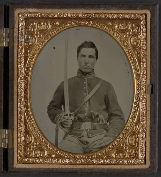 CIVIL WAR: SOLDIER, c.1863 Portrait of a Union cavalry soldier holding a revolvers and a saber. Ambrotype, c.1863.