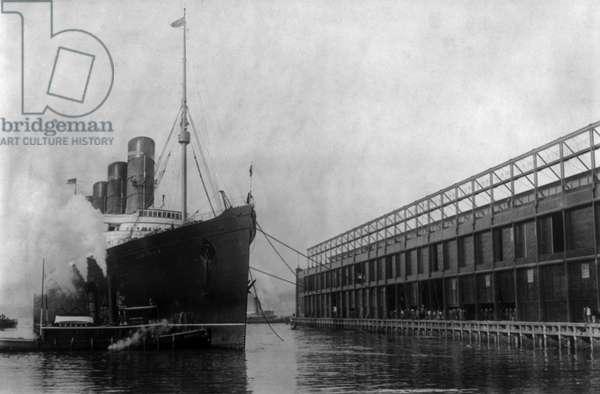 NEW YORK: LUSITANIA, 1908 The Cunard steamship 'Lusitania' at New York Harbor, 20 November 1908.
