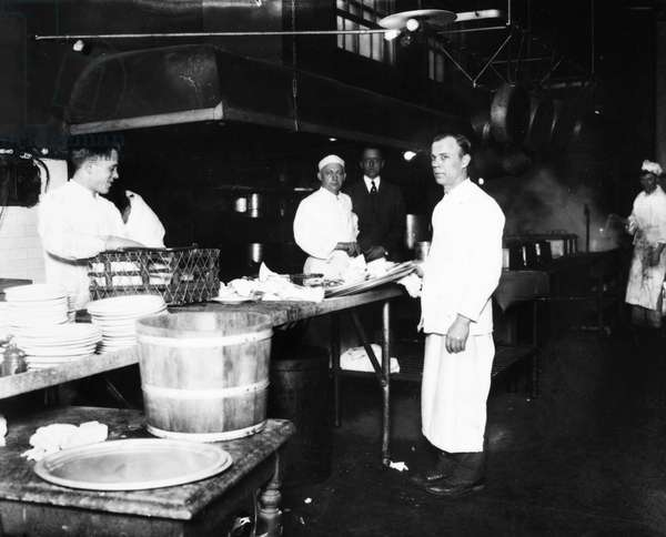 ELLIS ISLAND: KITCHEN A kitchen at Ellis Island, the immigration station in New York Harbor, c.1920.
