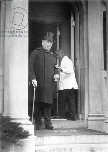 WOODROW WILSON (1856-1924) 28th President of the United States. Photographed in 1921 leaving his home in Washington, D.C.